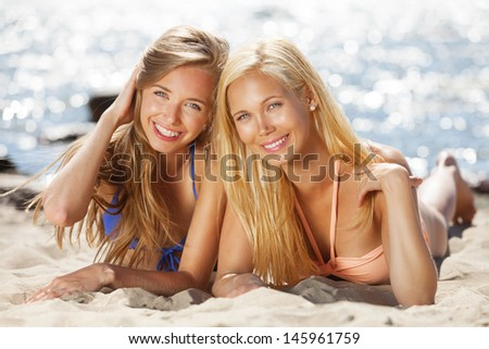 Girlfriends having good time on the beach - stock photo