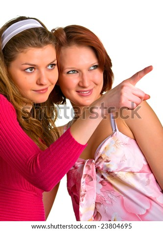 girlfriends laugh over something or someone over