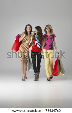 girlfriends looking happy shopping walking - stock photo