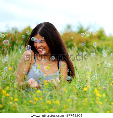 girlfriends on green grass - stock photo