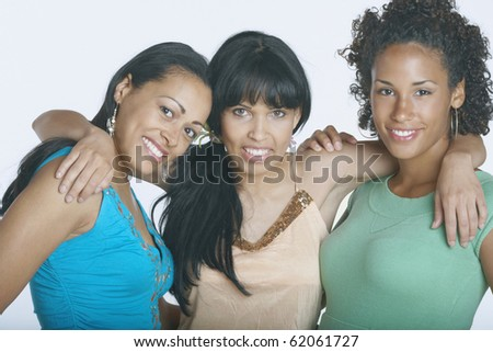 Girlfriends smiling for the camera - stock photo