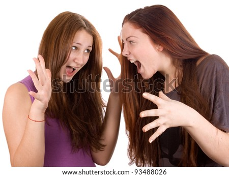 Girls are angry, argue and shout at each other - stock photo