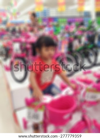 Girls are buying a bike is a blur. - stock photo