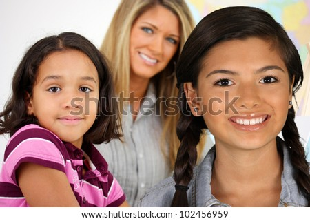 Girls At School With Their Teacher In A Class - stock photo