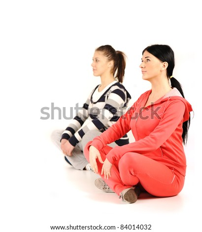 girls at the gym doing yoga - stock photo