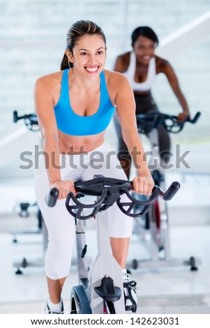 Girls  at the gym looking very happy - stock photo