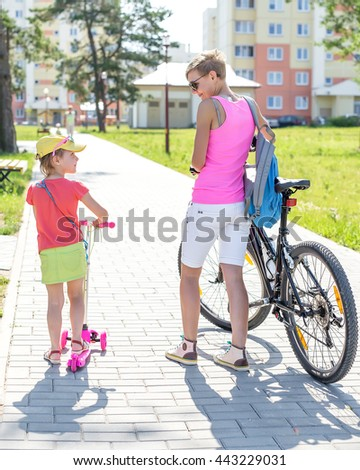 girls bike and scooter - stock photo