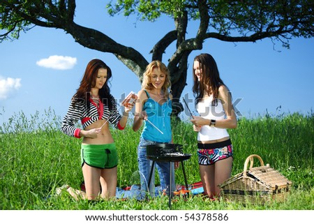 girls burn sausages - stock photo