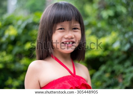 Girls ,cheerful ,mood, happy, kid, girl, pretty, childhood, asian, happy, asian, little,beautiful, portrait, red, thoughtful, musing, pensive, dress, calm, quiet, cute, daydream, reverie, smile, - stock photo