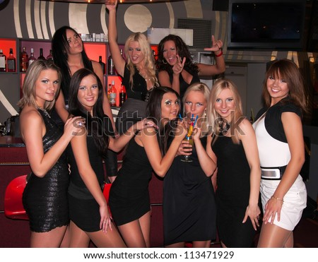 Girls company having fun in the night club - stock photo