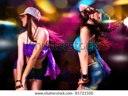 girls dancing in discolight - stock photo