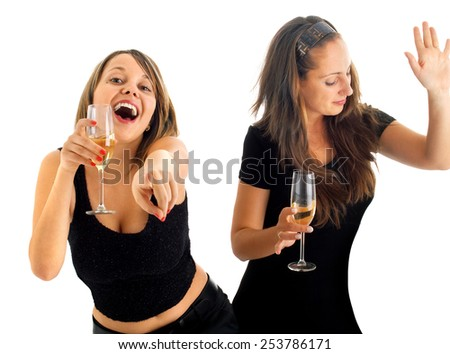 Girls dancing with champagne - stock photo