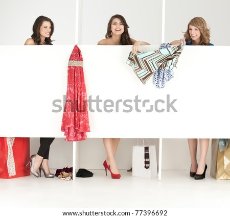 girls discussing over clothes shop wordrobe laughing - stock photo