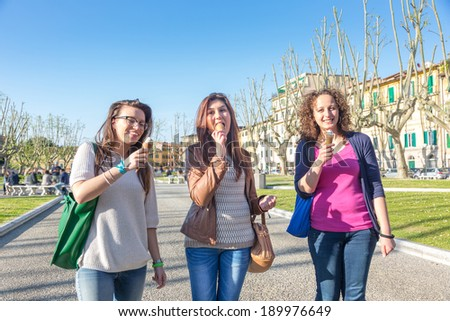 Girls Eating Ice Cream in the City - stock photo