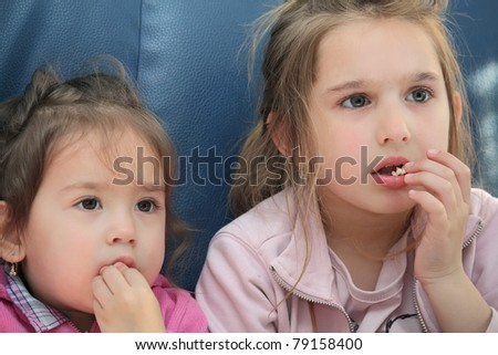 girls eating pop corn - stock photo