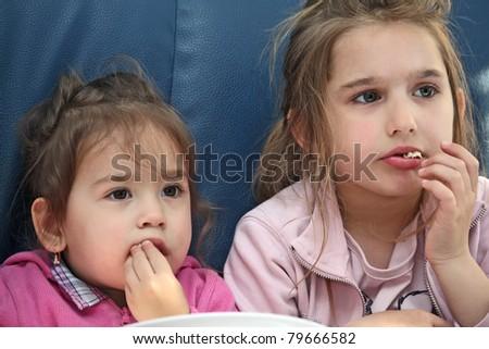 girls eating pop corn - stock photo