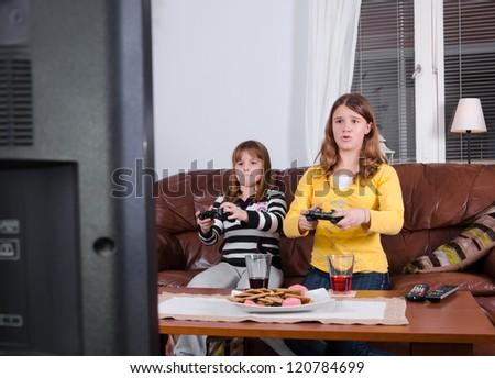 Girls enjoy the tv game - stock photo