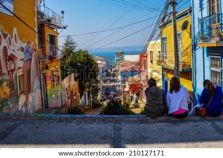 Girls enjoying the streets of Valparaiso, Chile. - stock photo