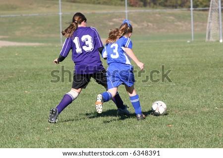 Girls Fighting for Soccer Ball - stock photo