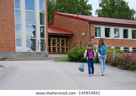 Girls go to school - stock photo