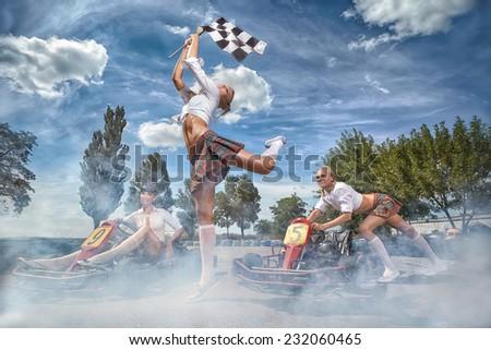 Girls going to drive Go-kart at start - stock photo