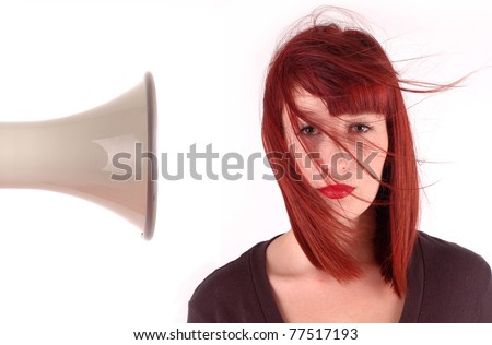 Girls hair blown away by megaphone - stock photo