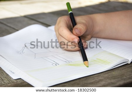 girls hand is drawing a nice picture - stock photo