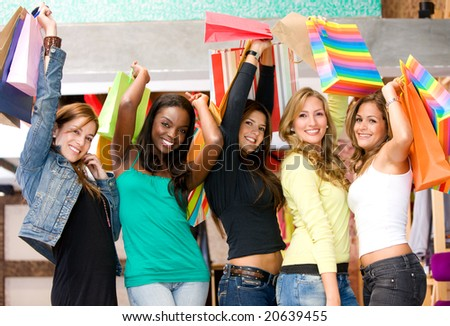 girls happy with shopping bags in a store - stock photo