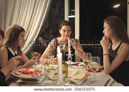 girls having dinner together - stock photo
