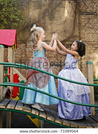 Girls having fun at the playground - stock photo