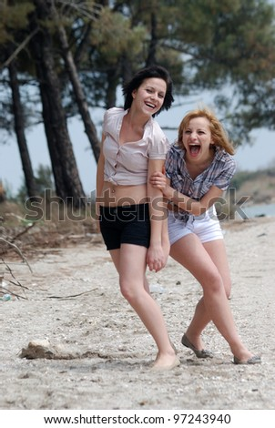 Girls having fun , enjoying the nature and posing for the photographer
