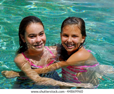 girls having fun in pool