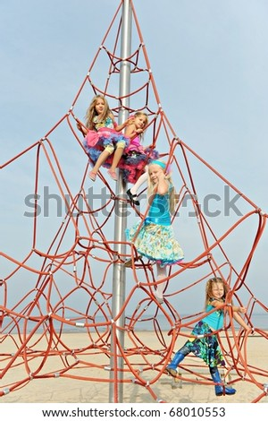 Girls having fun on the playground on the beach