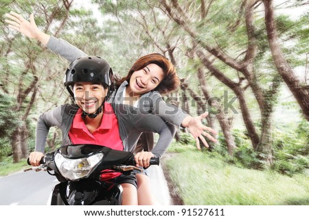 Girls having fun riding a motorcycle - stock photo