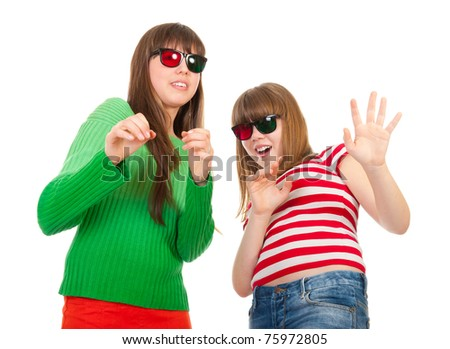 Girls having fun while watching 3D movie isolated on white background - stock photo