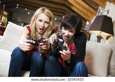 girls having fun with a new videogame