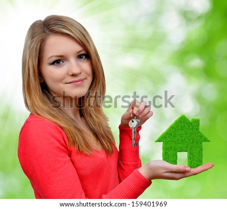 girls holding in hands green house  - stock photo