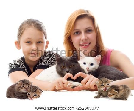 girls hugging cats - stock photo