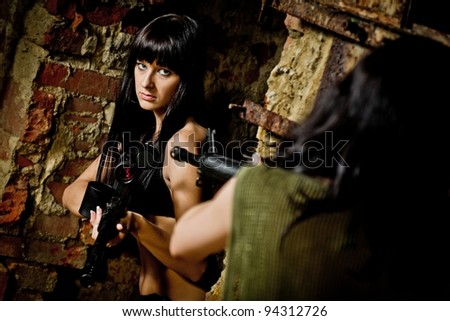 Girls in bikini with paintball markers - stock photo