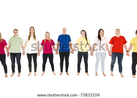 Girls in colored shirts holding hands isolated on white background - stock photo