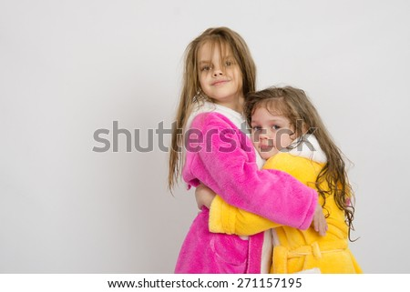 Girls in gowns hug after swimming