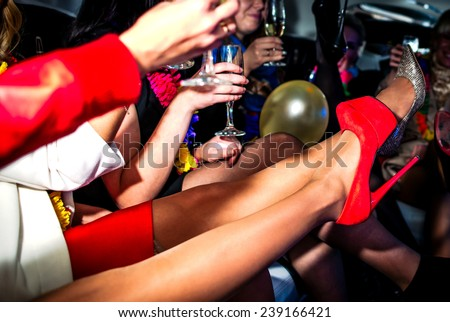 Girls in limo at hen-party - stock photo