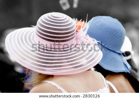 Girls in Pretty Hats Watch an Event Together (shallow focus, soft focus effect, color to black & white effect). - stock photo