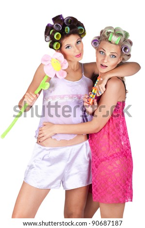 Girls in pyjamas with hair curlers have pyjamas party isolated on white background. - stock photo