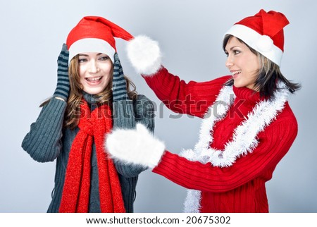 Girls in Santa's caps having fun