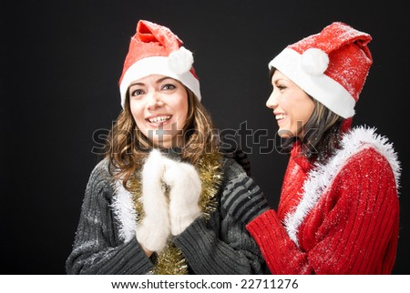 Girls in Santa's caps laughing