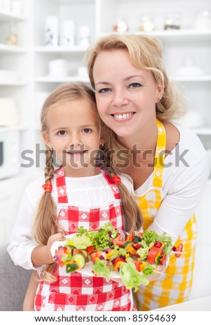 Girls in the kitchen preparing a vegetables snack
