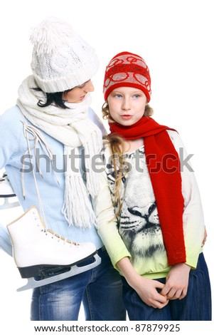 girls in the winter caps with the skates - stock photo