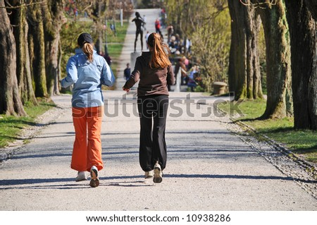 Girls jogging in the park - stock photo