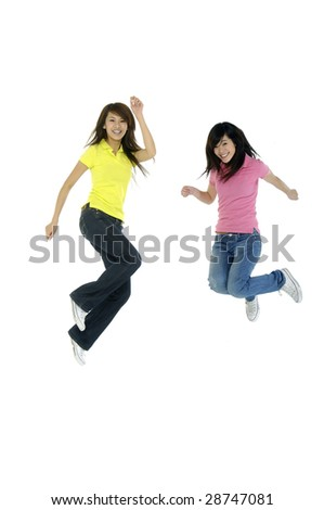 Girls jump in studio on a white background